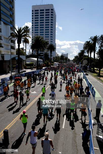 Runners walk through the chute after crossing the finish line of the 2020 Los Angeles Marathon on March 08 2020 in Los Angeles California