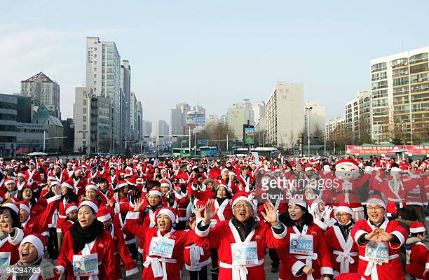 Runners warm up before competing in the Santa Marathon during Santa Sport Festival at Olympic Park on December 12 2009 in Seoul South Korea The event...