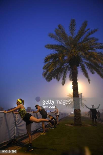 Runners warm up prior to the Standard Chartered Dubai Marathon on January 26 2018 in Dubai United Arab Emirates