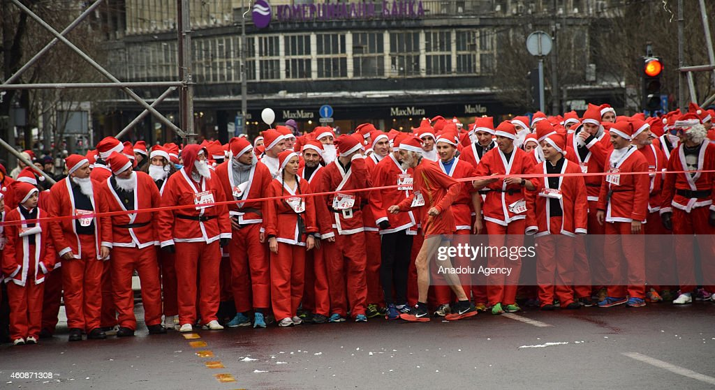Runners wearing Santa Claus costumes take the start of the traditional New Year's Santa Claus Race in Belgrade, Serbia on December 28, 2014. It is reported that the funds raised during this year's race will be granted to the Association of Parents of Children with malignant diseases.