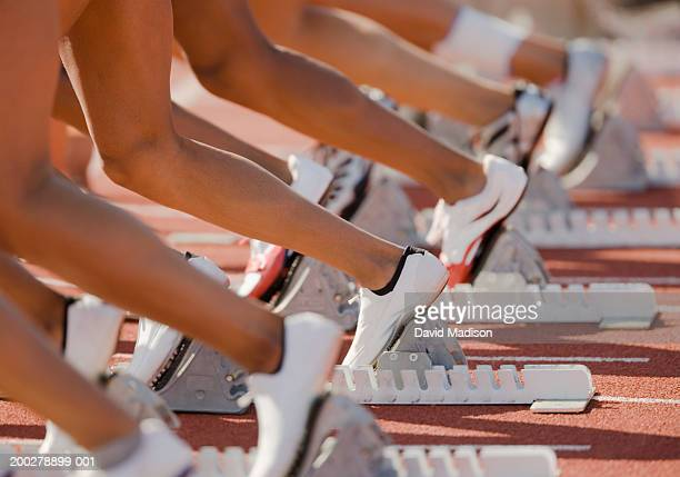 Runners with feet in starting blocks, low section