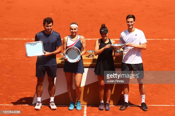 Runners-up Aslan Karatsev and Elena Vesnina of Russia and winners Desirae Krawczyk of The United States and Joe Salisbury of Great Britain pose with...