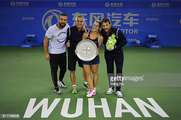 runnersup Dominika Cibulkova of Slovakia pose for a picture with their trophy on day 7 of 2016 Dongfeng Motor Wuhan Open at Optics Valley...