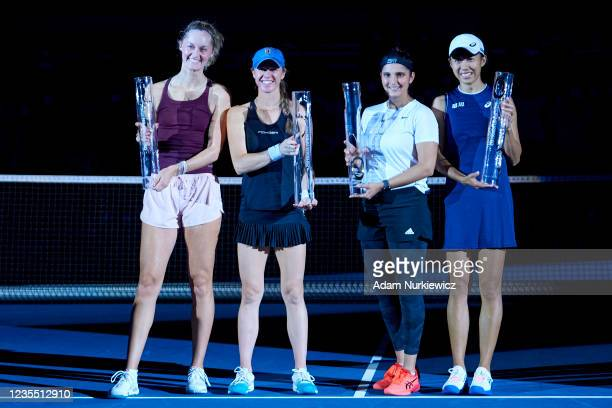 Runners-up Erin Routliffe of New Zealand and Kaitlyn Christian of The United States and winners Sania Mirza of India and Shuai Zhang of China pose...