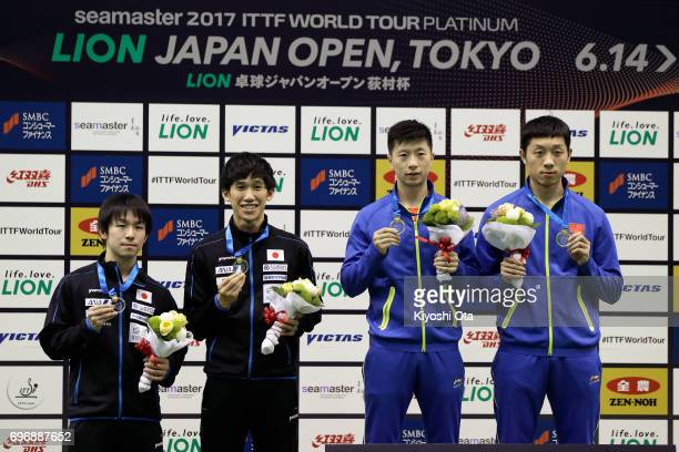 Runners-up Koki Niwa and Maharu Yoshimura of Japan, and winners Ma Long and Xu Xin of China pose with their medals after the Men's Doubles final...