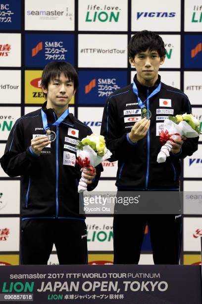 Runnersup Koki Niwa and Maharu Yoshimura of Japan celebrate with their medals after the Men's Doubles final match against Ma Long and Xu Xin of China...