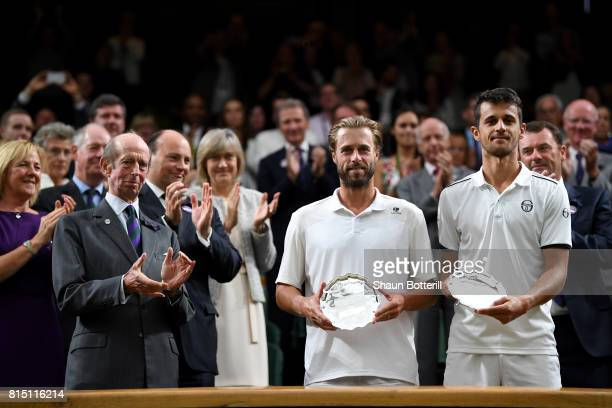 Runnersup Oliver Marach of Austria and Mate Pavic of Croatia pose with their trophies after the Gentlemen's Doubles final against Marcelo Melo of...