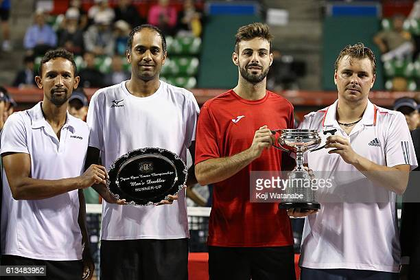 Runnersup Raven Klaasen of South Africa and Rajeev Ram of United States pose with a plate and winners Marcel Granollers of Spain and Marcin Matkowski...