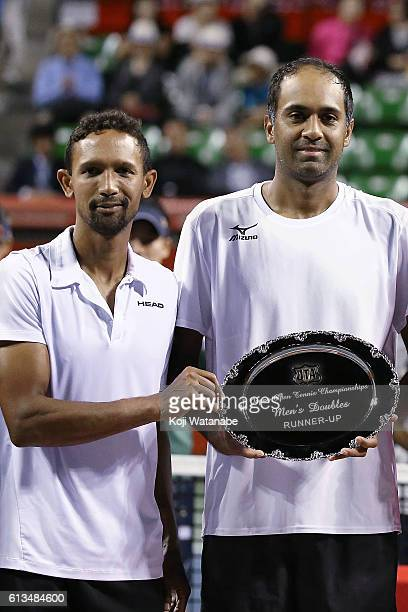 Runnersup Raven Klaasen of South Africa and Rajeev Ram of United States pose with the plate after losing the men's doubles final match against Marcel...