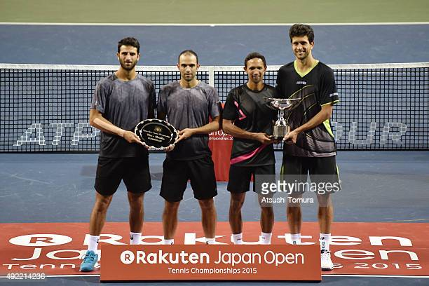 Runnersup Robert Farah of Colombia Juan Sebastian Cabal of Colombia celebrate with the plate and winners Raven Klaasen of South Africa and Marcelo...