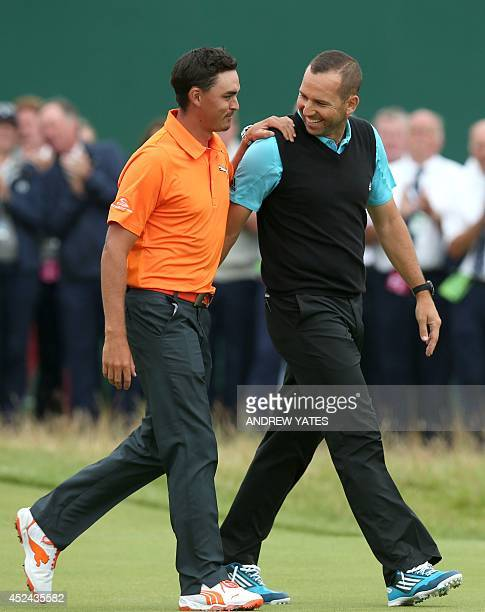 Runnersup Spain's Sergio Garcia and US golfer Rickie Fowler smile at the trophy presentation after they both finish two strokes behind winner...