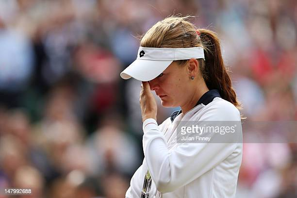 Runnerup Agnieszka Radwanska of Poland wipes away her tears after losing her Ladies' Singles final match against Serena Williams of the USA on day...