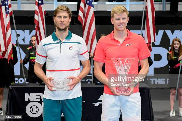 Runner-up Andreas Seppi of Italy and champion Kyle Edmund of Great Britain pose with their trophies following the Men's Singles final match on day...