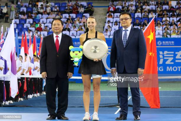 Runnerup Anett Kontaveit of Estonia holds the trophy after Women's Singles final match against Aryna Sabalenka of Belarus on Day 9 of 2018 WTA Wuhan...