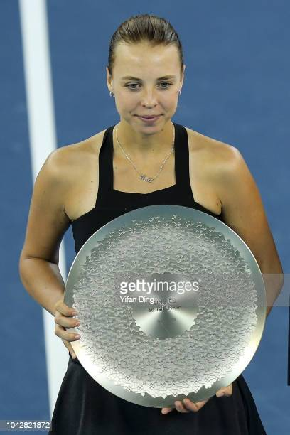 Runnerup Anett Kontaveit of Estonia poses with trophy for photo during victory ceremony after the singles final against Aryna Sabalenka of Belarus on...