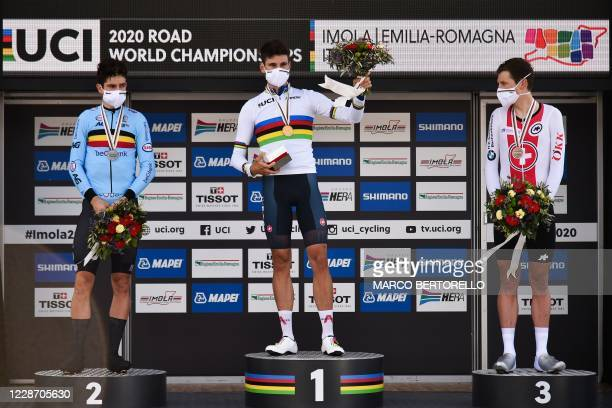Runner-up Belgium's Wout van Aert, winner Italy's Filippo Ganna and third-placed Switzerland's Stefan Kung celebrate on the podium after the Men's...