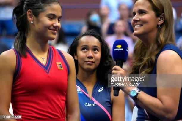 Runner-up Canada's Leylah Fernandez looks on as Britain's Emma Raducanu is interviewed after winning their 2021 US Open Tennis tournament women's...