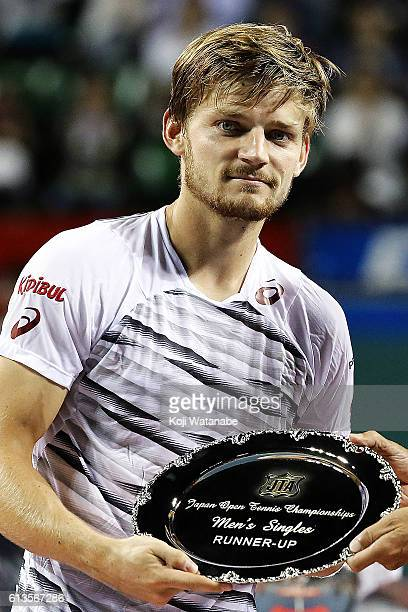 Runnerup David Goffin of Belgium poses with his plate after men's singles final match against Nick Kyrgios of Australia on day seven of Rakuten Open...