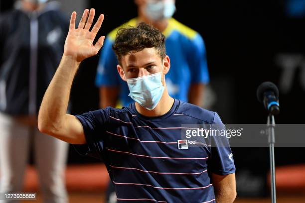 Runner-up Diego Schwartzman of Argentina shows appreciation to the fans as he speaks in the presentation ceremony after loosing his men's final match...