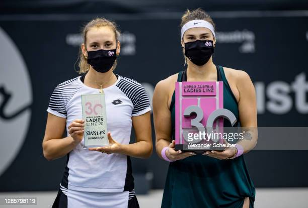 Runner-up Elise Mertens of Belgium and Aryna Sabalenka of Belarus pose with the trophies during the finals of the Upper Austria Ladies Linz at...