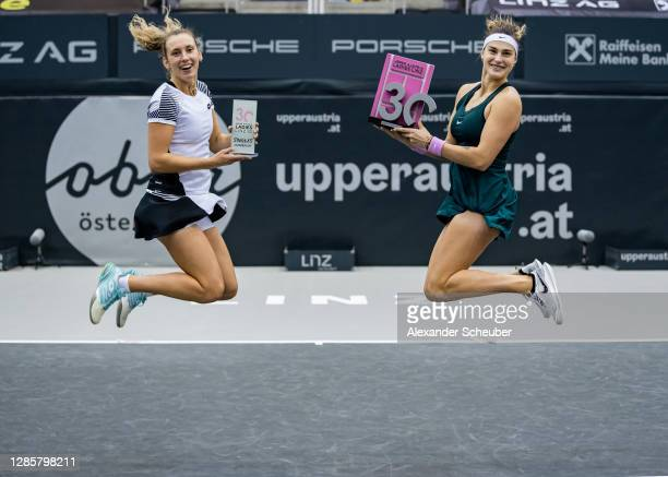 Runnerup Elise Mertens of Belgium and Aryna Sabalenka of Belarus pose with the trophies during the finals of the Upper Austria Ladies Linz at...
