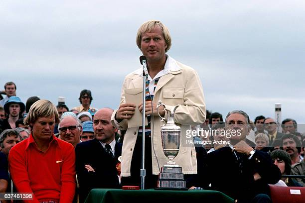 Runnerup Jack Nicklaus considers his speech as Open Champion Johnny Miller bows his head modestly