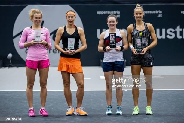 Runner-up Katerina Siniakova and Lucie Hradecka of Czech Republic pose next to doubles winner Tamara Zidansek of Slovenia and Arantxa Rus of the...