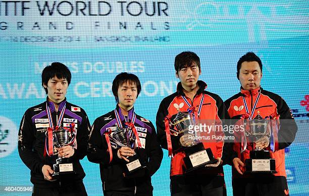 Runner-up Kenta Matsudaira, Koki Niwa of Japan and winner Seo Hyundeok, Cho Eonrae of Korea pose with the trophy during the Men's double awarding...