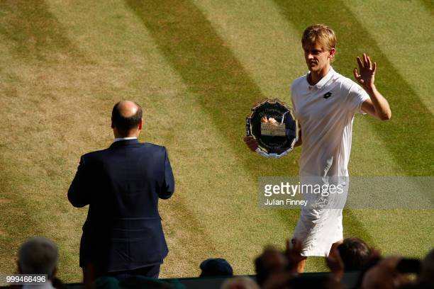 Runnerup Kevin Anderson of South Africa waves to the crowd during the trophy presentation after the Men's Singles final against Novak Djokovic of...