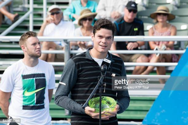 Runnerup Milos Raonic of Canada after a walkover to Jack Sock of USA with the Championship Singles Trophy at the Delray Beach Open on February 26...