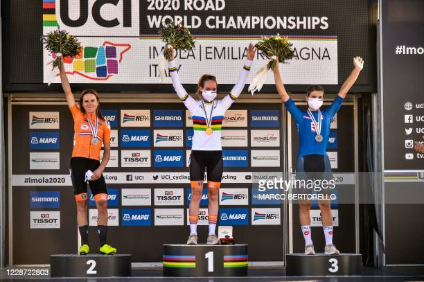 Runner-up Netherlands' Annemiek van Vleuten, winner Netherlands' Anna van der Breggen and third-placed Italy's Elisa Longo Borghini celebrate on the...