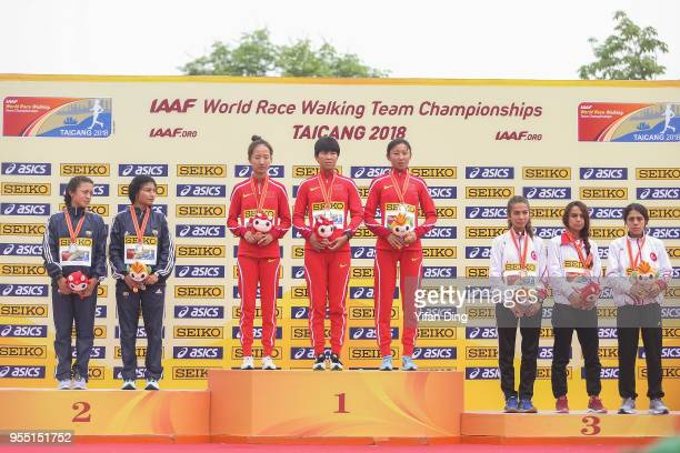 Runnerup team Ecuador winner team China and third place team Turkey pose for photo during medal ceremony of Women's 10 kilometres Race Walk of IAAF...