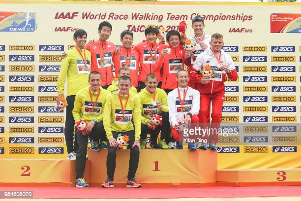 Runnerup team Ukraine winning team Japan and third place Poland take a group shot during the team medal ceremony of Men's 50 kilometres Race Walk of...