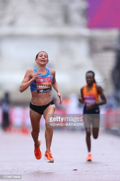 Runnerup US runner Sara Hall sprints away from Kenya's Ruth Chepngetich at the finish of the women's race of the 2020 London Marathon in central...