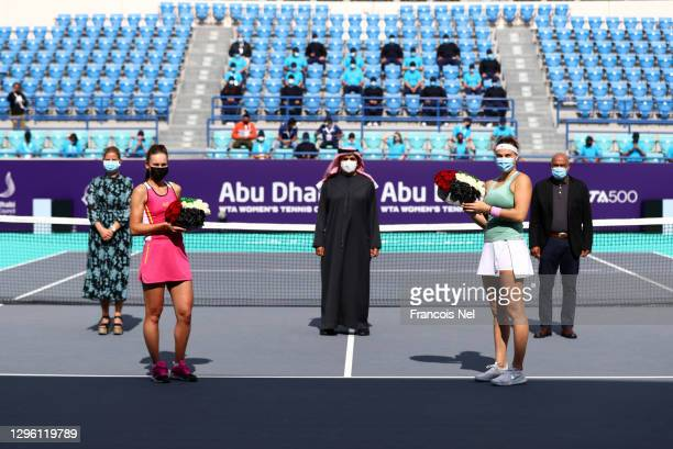 Runner-up Veronika Kudermetova and Aryna Sabalenka of Belarus is seen during the presentation after the her women's singles final match on Day Eight...
