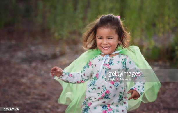 Running 2 Year Old Girl With Green Cape