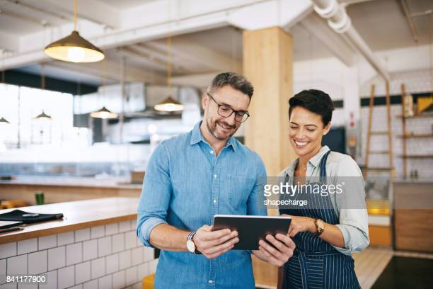 running a coffee shop using a smart management system - business owner stock photos and pictures
