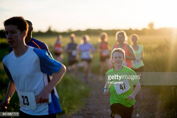 running a race outdoors - 5000 meter stock pictures, royalty-free photos & images