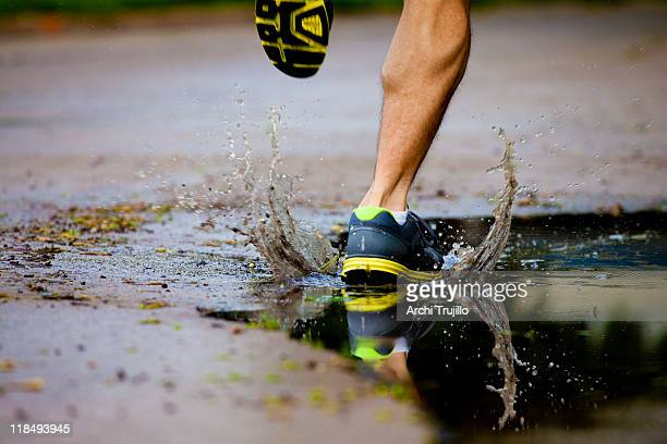 running after a morning rain - puddle stock pictures, royalty-free photos & images