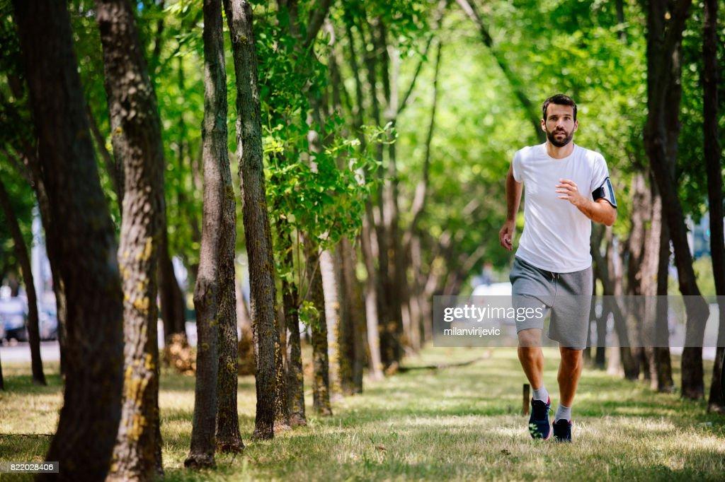 Running alone in nature : Stock Photo