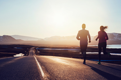 Running along road at sunrise in Iceland - gettyimageskorea