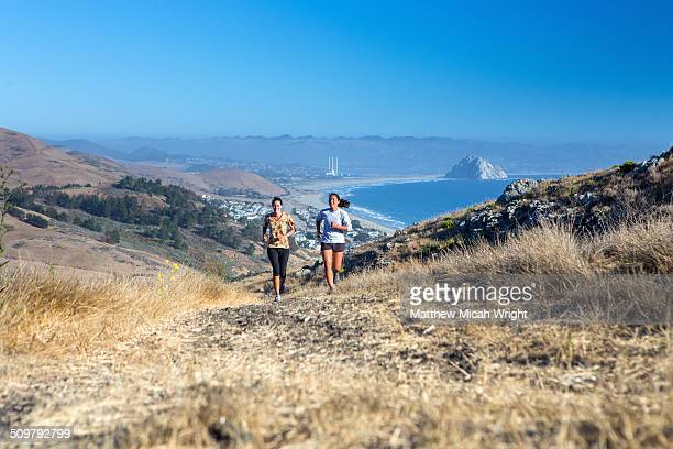running along the coastal bluffs of cayucos. - cayucos stock pictures, royalty-free photos & images
