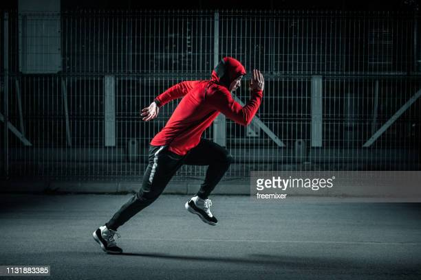 running at night - hooded shirt stock pictures, royalty-free photos & images