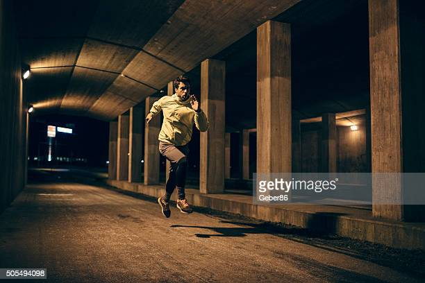 running at night - high contrast stock pictures, royalty-free photos & images