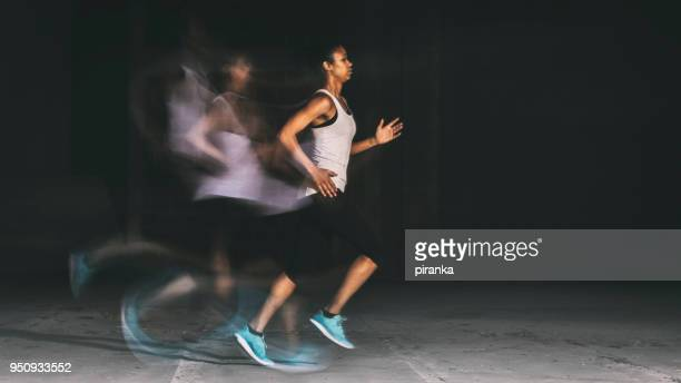 running at night - female streaking stock pictures, royalty-free photos & images