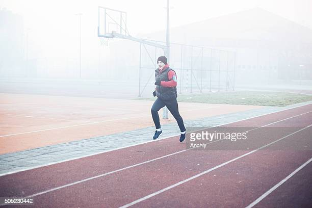 running athlete exercising for fitness and health outdoors - armband stock pictures, royalty-free photos & images