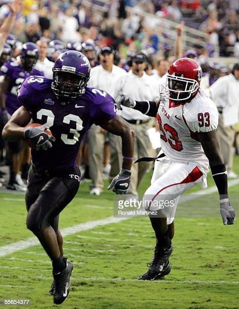 Running back Aaron Brown of the Texas Christian University Horned Frogs runs past Martail Burnett of the Utah Utes on September 15, 2005 at Amon...
