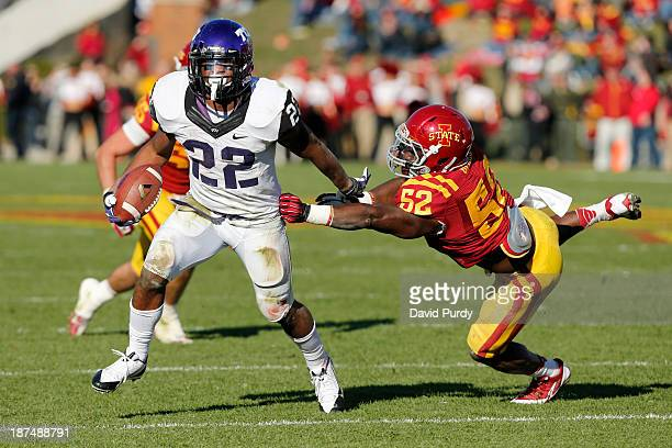Running back Aaron Green of the TCU Horned Frogs drives the ball past linebacker Jeremiah George of the Iowa State Cyclones for yards in the second...