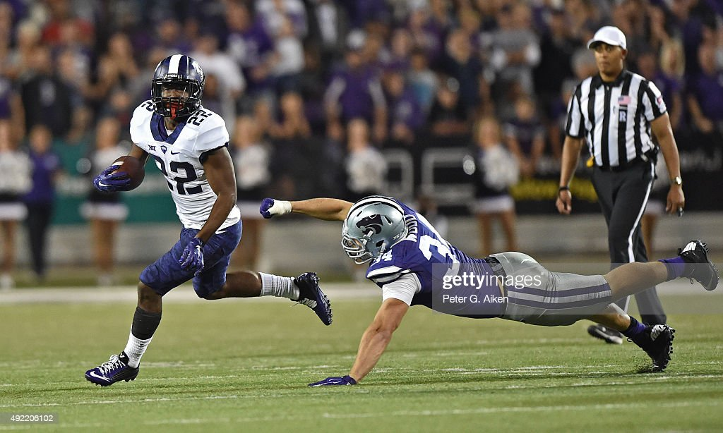 Running back Aaron Green #22 of the TCU Horned Frogs runs past linebacker Tanner Wood #34 of the Kansas State Wildcats during the second half on October 10, 2015 at Bill Snyder Family Stadium in Manhattan, Kansas.