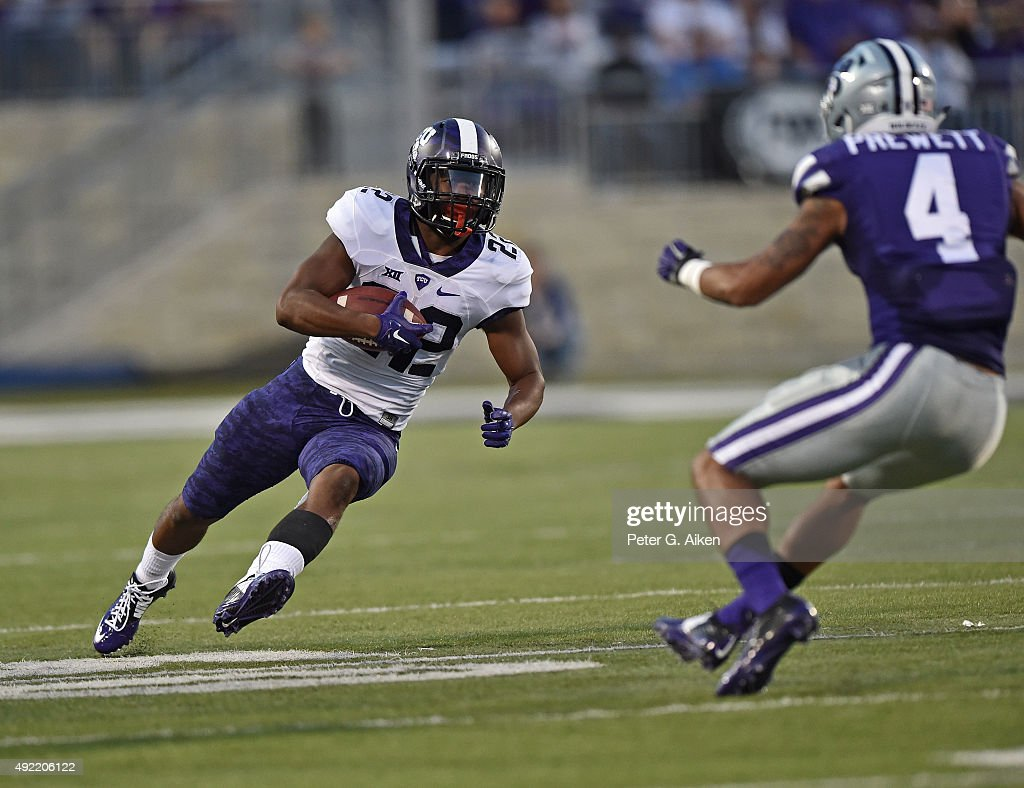 Running back Aaron Green #22 of the TCU Horned Frogs rushes up field against the Kansas State Wildcats during the first half on October 10, 2015 at Bill Snyder Family Stadium in Manhattan, Kansas.